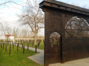 Traditional Szekely Gate and Transylvanian Wooden Markers at Plot 298