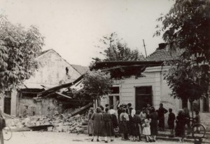 Civilians view damage to residential area after bombing of Kassa on June 26 1941