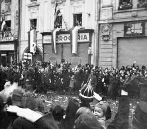 Hungarian leader Miklos Horthy walks  through the streets of Kassa to cheering crowds after the city was regained in 1938