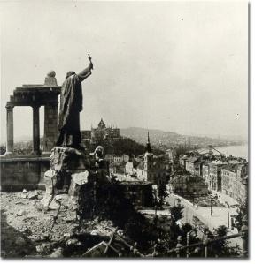 The statue of St. Gellert overlooking war torn Buda