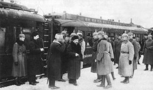 Russian delegates who negotiated the treaty arrive at Brest-Litovsk where they are greeted by German officers
