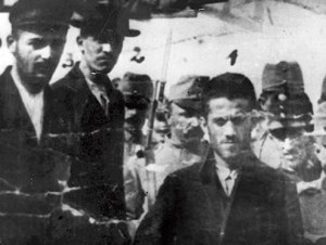 Cabrinovic on the far left and Princip on the far right (in the foreground) - escorted by Austro-Hungarian soldiers suring their trial for murder