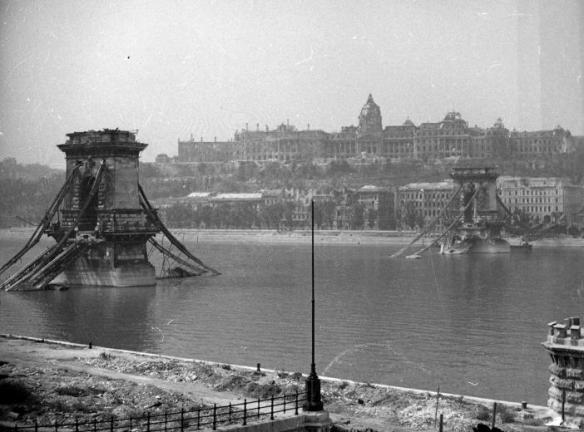 World War 2 hit Hungary hard  - badly damaged Chain Bridge with Buda Castle in the distance
