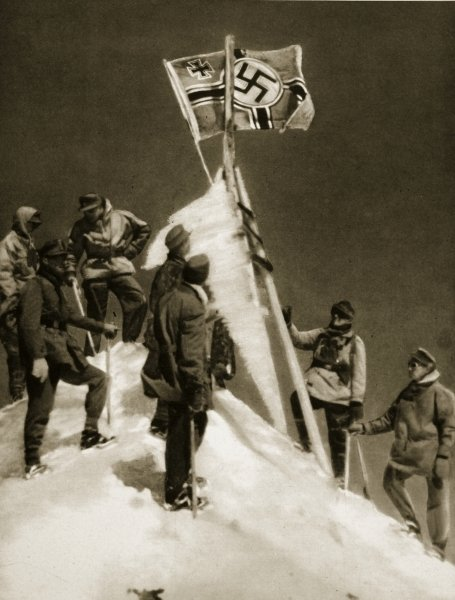 German Mountain troops with the Swastika flag on Mt. Elbrus - it was (literally) all down hill from there