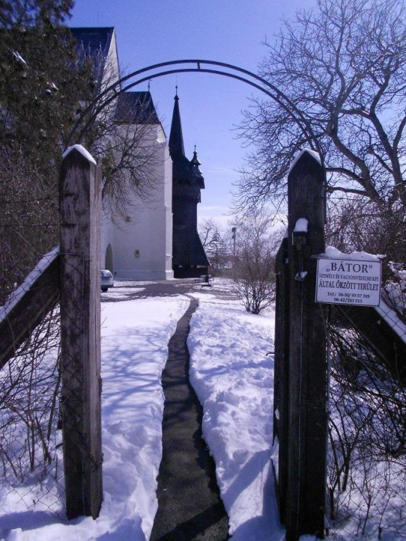 A wintry path to the Calvinist Church & Wooden Belfry in Nyirbator