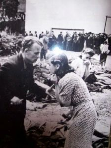 A woman is overcome with grief after identifying a victim