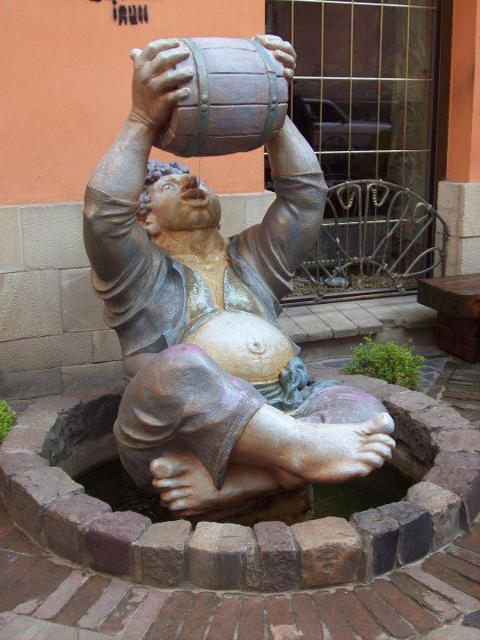 Statue of Bachhus Drinking Wine in Lviv - The Front Desk Attendant At My Hostel Took This To Heart