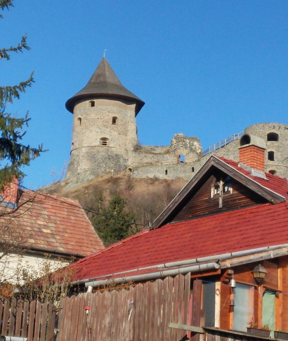 Somosko Castle looms above a house in the Hungarian village of the same name below it