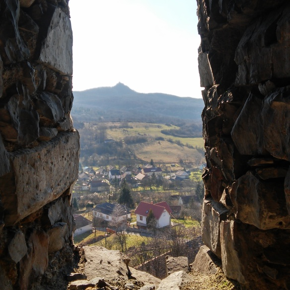 View from the tower of Somosko Castle looking over the village of the same name and the ruined hilltop castle of Salgo in the distance