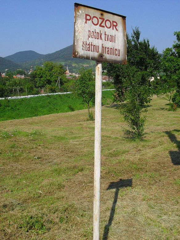 Old border post sign in Slovak in Slovenské Nové Mesto - Satoraljaujhely is literally a stone' throw away