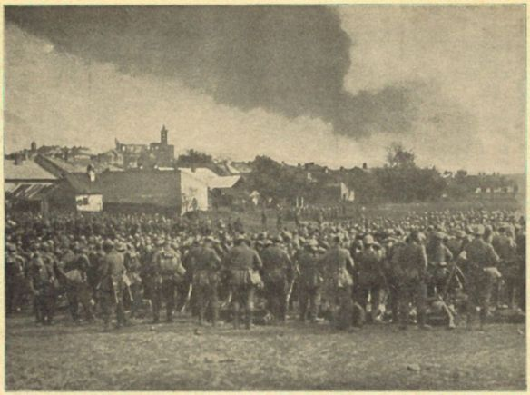 On the verge - soldiers look up at smoke rising above Gorlice in 1915