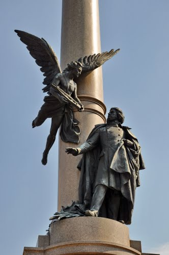 The winged genius of poetry brings Mickiewicz a lyre on the column