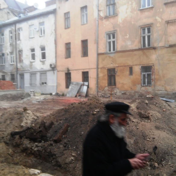 A man leaving the empty lot where the Golden Rose Synagogue once stood