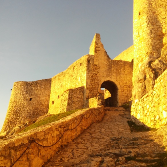 Late afternoon sunshine radiates off the limestone walls of Spiš Castle