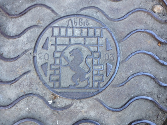 Lviv lion on a manhole cover
