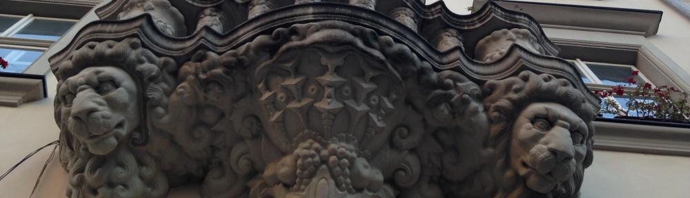 Lion sculptures on facade of Lviv residential building