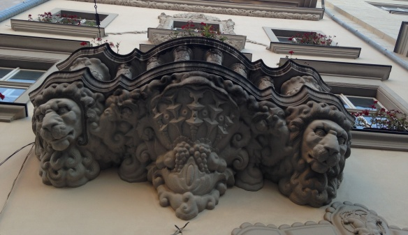 Lion sculptures on facade of Lviv residential building