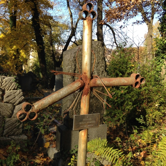 Bent cross in front of grave