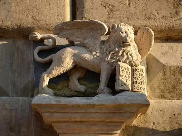 The Lion of St. Mark sculpture above the portal to the Venetian House at 14 Rynok Square
