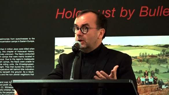 Father Patrick Desbois - speaking at a Holocaust By Bullets exhibition