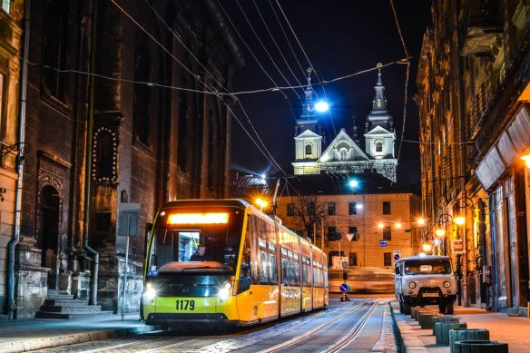 Post-modern arrival - one of the new Lviv trams in the Old Town at night