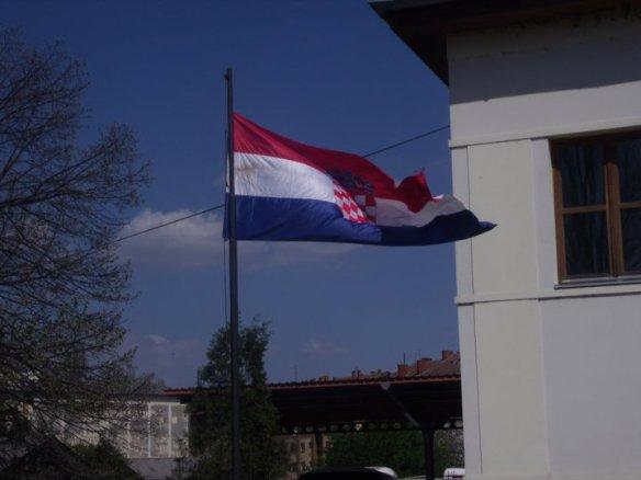 Croatian flag unfurls at the border crossing into Slavonia