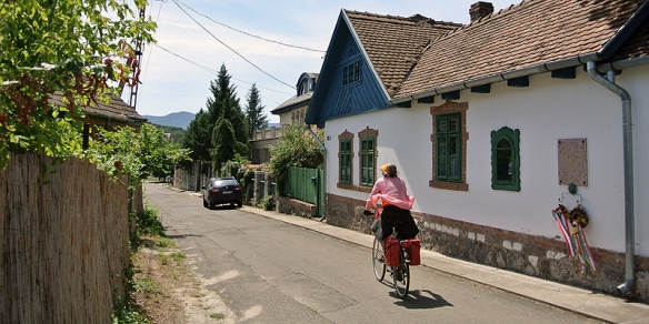 Cautious and courageous - a bicyclist in a Hungarian village