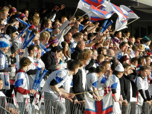Faroese football fans cheer on the national team in the Skansin (fort) section