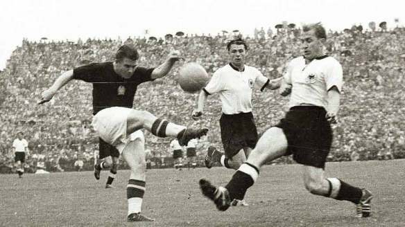 Fouled Up - Ferenc Puskas (dark uniform) takes on Werner Liebrich (right) in World Cup play