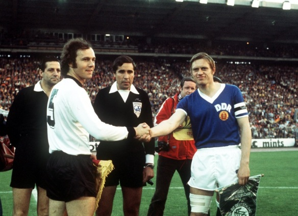 A match that was more than a game - West & East German captains shake hands before the historic match