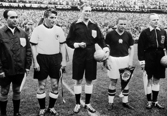 Captains before the kickoff - Fritz Walter and Ferenc Puskas with referee William Ling