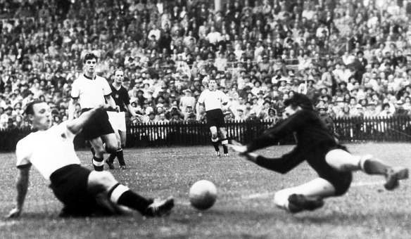 Max Morelock stretches out to score the West Germans first goal