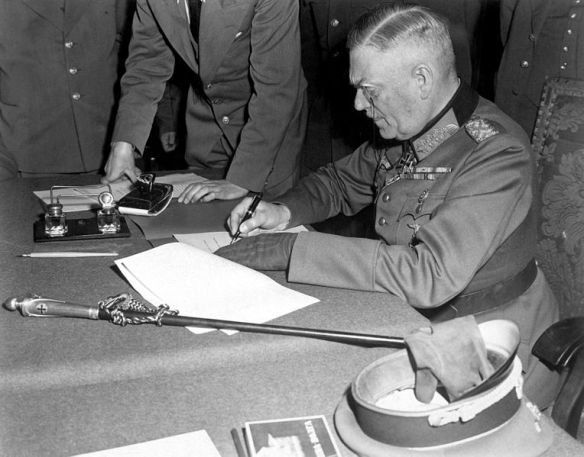 Field Marshal Wilhelm Keitel signs the German unconditional surrender at Karlshorst