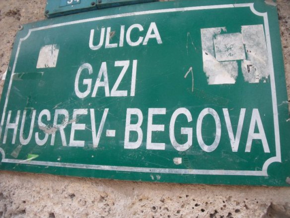 Street sign in Sarajevo - note the bullet holes below the sign