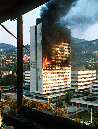A burning government building during the Siege of Sarajevo
