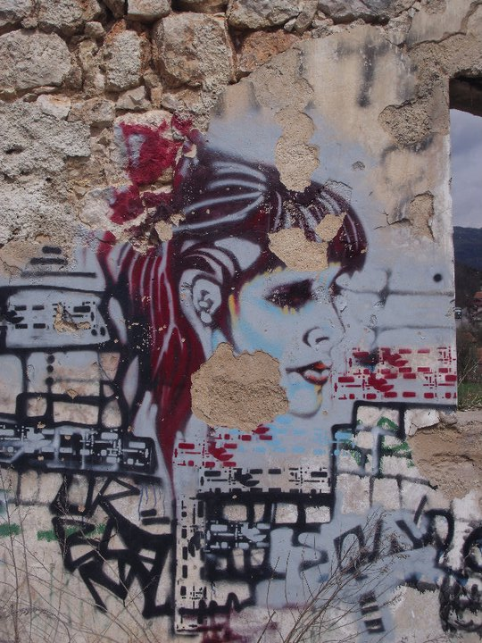 Graffiti on the ruins of a building in Sarajevo