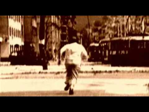 Man running through the streets of Sarajevo - scene from Miss Sarajevo