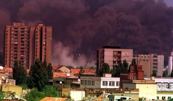 Black smoke billows up from a refinery struck by the NATO bombing of Novi Sad in 1999