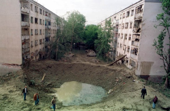 Crater from NATO missile strike between two apartment buildings and elementary school