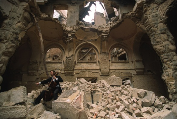 Vedran Smailović playing cello in the ruins of the Bosnian National & University Library in 1992