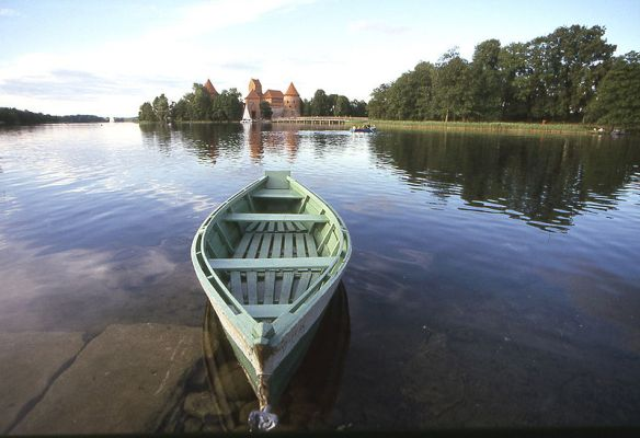 Ready to go - Boat on Lake Galve with Trakai Castle in the distance