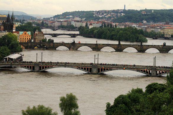 Ferocious flow - The Vltava River takes on the bridges of Prague