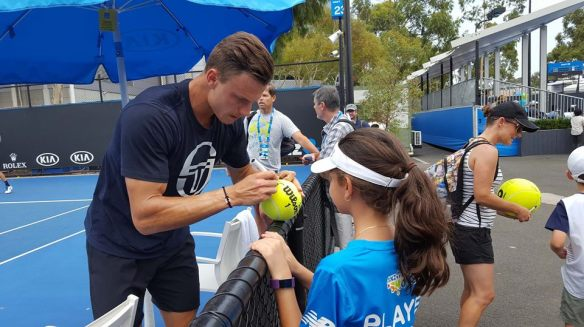 Hungarian Hero - Marci signs an autograph for a young fan at the Australian Open