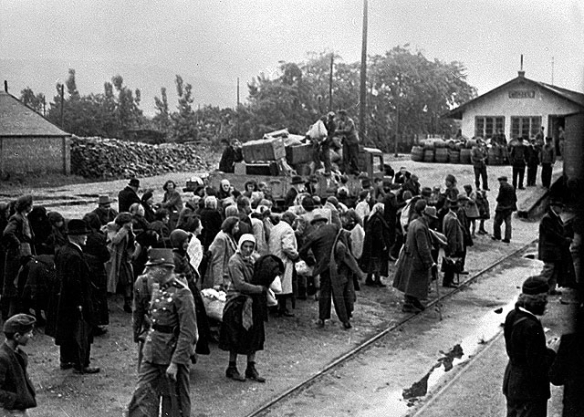 Traces of evil - Hungarian Jews in Kozseg await a train that will deport them to Auschwitz