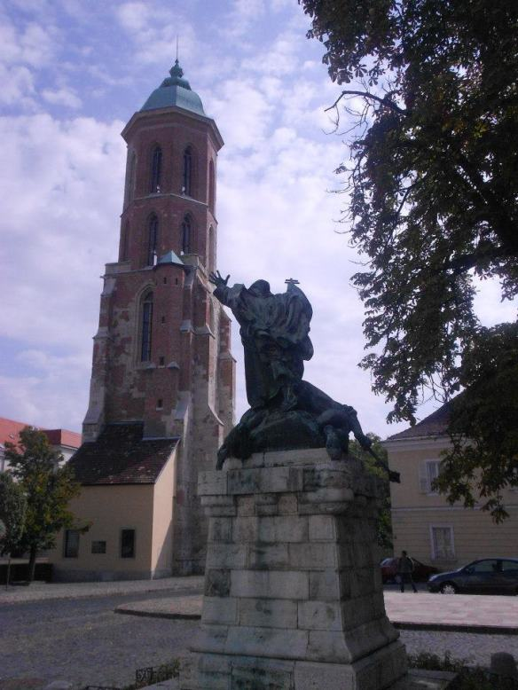 The Tower of the Church of Mary Magdalene - Statue of St. John of Capistrano in foreground