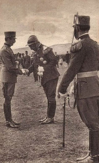 Take a bow - King Zog greeting one of his Royal Guard